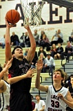 Photo Credit: PAMPLIN MEDIA GROUP: MATT SHERMAN - POWER POST -- Sherwood High School sophomore post Luka Nixon (left) goes up to the basket during the Bowmen's game at Lake Oswego on Friday. The Lakers got a 54-48 victory.