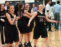 Photo Credit: DAN BROOD - WORKING EXTRA -- Sherwood's (from left) Kaitlyn Buys, Cami Reuter, Gabby Johnson and Jennah Stobie celebrate following the team's 46-43 overtime victory at Lake Oswego on Tuesday.
