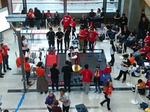 Photo Credit: PHOTO COURTESY: LESLIE ROBINETTE - The Kraxberger Gearheads, in the red shirts, show off in a regional robotics competition at Oregon State University.