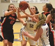 Photo Credit: PHOTO COURTESY OF FRED HOUSTON JR - Kimmer Severance fights for an offensive rebound with Molalla's Rachel Bring (45) and Haley Thrower. Severance grabbed 18 rebounds and scored 26 points as the Cowgirls edged the Indians 46-43 in overtime.