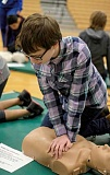 Photo Credit: RAY HUGHEY - A Baker Prairie Middle School eighth-grader works on his hands-only CPR technique during last week's course put on by local firefighters and the Legacy Health Middle School Heart Healthy Program.