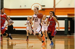 Photo Credit: JIM BESEDA/MOLALLA PIONEER - Molalla's Marissa Marr leads the transition rush during the first half of Tuesday's 41-28 home loss to Madras.