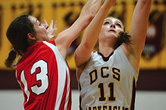 Photo Credit: THE OUTLOOK: DAVID BALL - Damascus Christians Hannah Forrar goes to the rim for two points against Trinitys Katie Murphy on Friday.