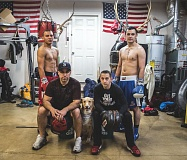 Photo Credit: NEWS-TIMES PHOTO: CHASE ALLGOOD - Local trainers Freddy Coronado (front left) and Mike Muniz pose with Golden Gloves boxers Jairo Estrada (back left) and Joel Gomez at Coronado's Cornelius garage.