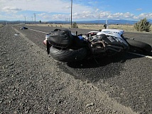 Photo Credit: PHOTO COURTESY OF OREGON STATE POLICE - A motorcyclist's saddle bag got caught in his wheel, causing a crash on Highway 216, on the northern boundary of the Warm Springs Reservation on Sunday.