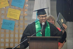 Photo Credit: PHIL HAWKINS - Sang Dao accepts his bachelor's degree during a commencement ceremony at MacLaren Youth Correctional Facility last June.