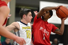 Photo Credit: THE OUTLOOK: DAVID BALL - Mt. Hood CC point guard Kylelle Brown works to get a shot off against Portlands Braden Taylor during Wednesdays 69-66 road win.