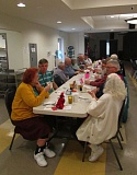 Photo Credit: MARK MILLER - Senior citizens eat lunch and socialize at the St. Helens Senior Center at noon Wednesday, Feb. 18. Cheryl Young, the center's manager, said it provides more than 30,000 meals every year.