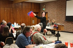 Photo Credit: FILE - Agnes Petersen demonstrates her vigor with a cheer routine at a candidates' forum last May. Petersen was disqualified from the ballot because she is older than 75, a decision she unsuccessfully appealed.