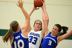 Photo Credit: THE OUTLOOK: DAVID BALL - Portland Lutheran center Sami Howard pulls down a rebound between a pair of Wildcats during Thursdays 34-23 Valley 10 playoff win.
