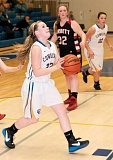Photo Credit: CENTRAL OREGONIAN FILE PHOTO - Michaeline Malott goes to the basket during the previous meeting between Crook County and Corbett. Malott scored seven points Tuesday night in the Cowgirls' 44-41 loss to the Cardinals.