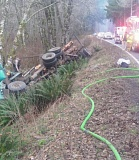 Photo Credit: COLUMBIA COUNTY SHERIFF'S OFFICE - Emergency crews respond to a crash on Apiary Road Thursday, Feb. 19. A man was killed after he lost control of the log truck he was driving.
