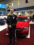 Photo Credit: COURTESY MERCEDES-BENZ OF WILSONVILLE - William 'Beau' Childs in front of the Mercedes-Benz CLA he was awarded at Mercedes-Benz of Wilsonville on Dec. 23, 2014.