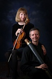 Photo Credit: SUBMITTED PHOTO - Gayle Neuman is pictured above holding a renaissance violin, and her husband, Phillip, is holding a dulcian (bassoon precursor); the Oregon City couple made both of the instruments.
