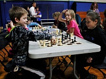 Photo Credit: POST PHOTO: KYLIE WRAY - Bernie Bast tests his knowledge of how the chess pieces move while playing with Eli Bishop.
