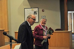 Photo Credit: NEWS-TIMES PHOTOS: JOHN SCHRAG - Forest Grove Mayor Pete Truax gives roses to his wife, Pat Truax, before his State of the City address Monday, thanking her for her support.
