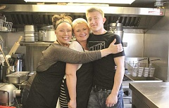 Photo Credit: LINDSAY KEEFER - Mary Ivanov (center), owner of From Russia with Love, is flanked by two of her children helping at the new Hubbard restaurant, manager Luba Reutov (left) and Alex Ivanov.