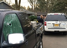 Photo Credit: SUBMITTED PHOTO - This photo shows a bullet hole in a truck window caused by Aloha's Troy Dean Haren after he shot up an Aloha neighborhood on Tuesday afternoon.