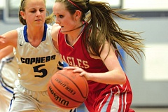 Photo Credit: THE OUTLOOK: DAVID BALL - Centennial point guard Melissa Dailey drives to the basket against Greshams Kacy Childress in Tuesdays 41-35 road win.