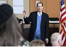 Photo Credit: HOLLY M. GILL - U.S. Sen. Ron Wyden responds to education concerns from Madras High School teacher Carrie McPeak, at left, during his annual town hall meeting Saturday, at the Madras City Hall.