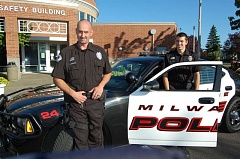 Photo Credit: RAYMOND RENDLEMAN - Officers Sean and Martin Stringer pull a Milwaukie Police Department patrol car in front of the Public Safety Building after a recent interview., Clackamas Review - News  Like father, like son, in Milwaukie Police Department