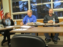 Photo Credit: COURTNEY VAUGHN - Port of St. Helens commissioners Collen DeShazer, Mike Avent and Robert Keyser discuss matters during a port meeting earlier this year. The three commissioners are up for re-election this year.
