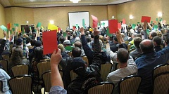 Photo Credit: TIMES PHOTO: ERIC APALATEGUI - Attendees at the Oregon Liquor Control Commission's open house on recreational marijuana rule-making use colored sheets of paper to signal their approval (green), disapproval (red) or uncertainty (yellow) to a question posed during the Feb. 26 session at the Embassy Suites hotel at Washington Square.