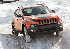Photo Credit: PORTLAND TRIBUNE PHOTO JOHN M. VINCENT - The Trailhawk badge represents the pinnacle of off-highway capability for both the Jeep Cherokee and the new 2015 Jeep Renegade. The Cherokee Trailhawk's sophisticated traction management system can maintain grip when even 1 or 2 wheels are off of the ground. With increased ground clearance and skid plating, critical components on the underside of the Jeep are well protected.