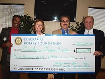 Photo Credit: SUBMITTED PHOTO - Celebrating a successful fundraiser are, from left, Thomas Joseph of the Rotary Club Foundation; Barbara Peschiera, Children's Center executive director; Ed Hacmac, Rotary Club president, and Clackamas County District Attorney John Foote.