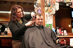 Photo Credit: CONNECTION PHOTO: KELSEY O'HALLORAN - Bishops Barbershop stylist Daysha Hamilton gives a haircut to Steve Tompkins.