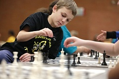 Photo Credit: TRIBUNE PHOTO: JONATHAN HOUSE - Landon Harris looks to make a move during a Feb. 28 regional Chess for Success tournament at Shaver Elementary School. The program targets schools in low-income communities to offer free after-school programming to elementary-aged students.