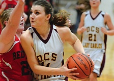Photo Credit: THE OUTLOOK: DAVID BALL - Damascus Christians Hannah Forrar looks to get to the hoop for two of her game-high 27 points Saturday night.