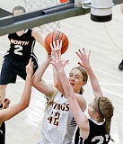 Photo Credit: NEWS-TIMES PHOTO: CHASE ALLGOOD - Forest Grove sophomore Maddy Closson goes up for a shot against North Salem's Elizabeth Ming last Tuesday night.