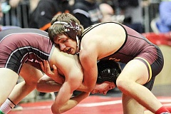 Photo Credit: NEWS-TIMES PHOTO: AMANDA MILES - Forest Grove junior Matthew Johnson wrestles against Glencoe's Ian Stettler in the 126-pound semifinal at Saturday's Class 6A state meet.