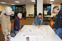 HILLSBORO TRIBUNE PHOTO: DOUG BURKHARDT - George Hudson, a principal with Portland-based Alta Planning & Design, hired by Hillsboro to be the consultant team for the citys master planning process, refers to a large map as he discusses trail options with citizens at last weeks Hillsboro trails system master plan open house.