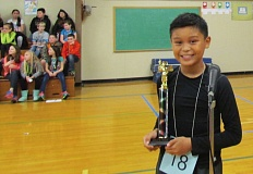 OUTLOOK PHOTO: TERESA CARSON - East Oreint Elementary School spelling bee winner Brandon Susi shows off his trophy.
