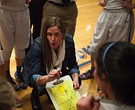 ADAM WICKHAM - La Salle Prep coach Kelli Wedin maps out strategies during Saturday nights 64-28 state playoff win over Ridgefield.