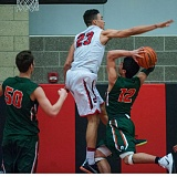 JOHN LARIVIERE - Clackamas senior Markus Golder (23) leaps high to contest a shot by Cole Conklin (12) in last weeks game with Wilson.