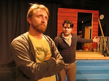 PHOTO BY DICK TRTEK - Dallas Myers, left, and Aaron Filyaw rehearse a tense scene in 'All My Sons,' the latest offering from the New Century Players, opening March 13.