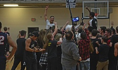 TIMES PHOTO: MATT SINGLEDECKER - Southridge senior Isaiah Reel and the Skyhawk boys basketball celebrate their state tournament-clinching win over Lake Oswego on Friday in the second round of the 6A playoffs.
