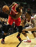 TRIBUNE PHOTO: JAIME VALDEZ - Alonzo Gee (right) of the Trail Blazers defends Houston Rockets guard James Harden at Moda Center.
