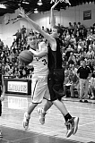 BRAD CANTOR - Payton Pritchard draws contact while putting up a shot in last week's second-round playoff game against Sheldon. Pritchard led all scorers with 30 points in the victory.