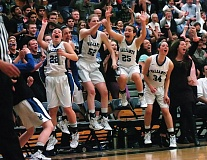 DAN BROOD - Valley Catholic's (from left) Emily McLeod, Bailey McDevitt, Noelle Mannen and Petra Flemmer cheer on their teammates during the final moments of the team's 61-30 state tournament win over Seaside.