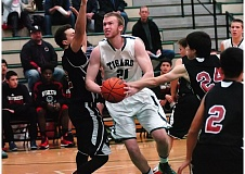 DAN BROOD - Tigard senior post Joel Johnson was a first-team All-Three Rivers League selection and he also shared the league's Defensive Player of the Year honors.