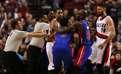 COURTESY OF DAVID BLAIR - Referees move in to help with a late-game scuffle that wound up with ejections to Trail Blazers big man Joel Freeland (right) and Detroit Pistons forward Shawne Williams (3).