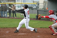 JIM BESEDA/MOLALLA PIONEER - Austin Alexander's two-out, RBI-double highlighted a four-run third inning that help carry Molalla to a 10-4 victory over Seaside Tuesday.