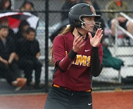 TRIBUNE PHOTO: JONATHAN HOUSE - Central Catholic's Ashley Doyle claps as she scores against against Sandy.