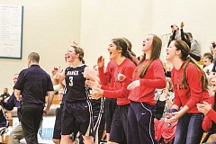 NEWS-TIMES PHOTO: AMANDA MILES - The Banks bench, including (from left) Jojo Wren, Sydney Gregg, Destiny Maller and Jessi Wren, gets fired up during the Braves' 44-37 comeback victory against Seaside last Friday at Century High School. The win assured Banks of finishing the Class 4A state tournament with a team trophy.