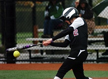 DAN BROOD - BOWMEN BAT -- Sherwood High School senior outfielder Grace McClain gets her bat on the ball during a game last year. McClain looks to be a key returnee for the 2015 Lady Bowmen squad.