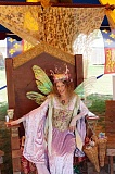 HILLSBORO TRIBUNE FILE PHOTO: DOUG BURKHARDT - The festival featured a variety of performers in vibrant costumes, such as this fairy resting in the courtyard.